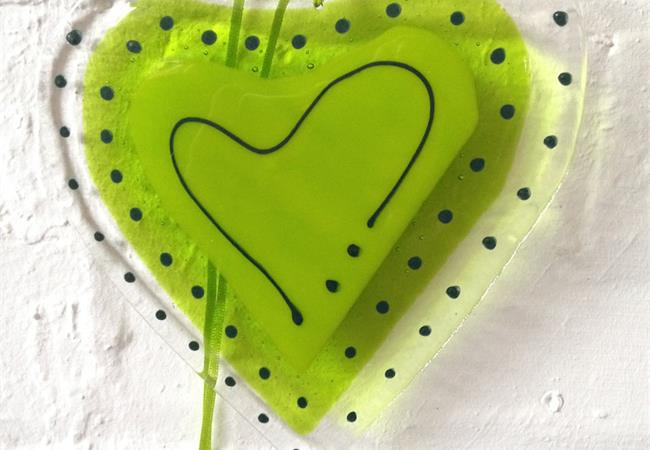 Big green fused glass love heart hanging decoration made by molten wonky