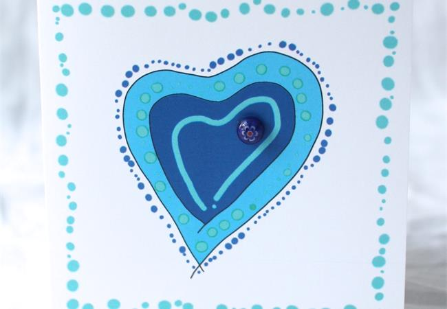 Blue heart design gift card with glass bloblet on