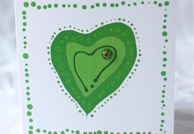 Green heart design gift card with glass bloblet on