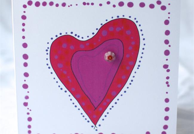 Red heart design gift card with glass bloblet on