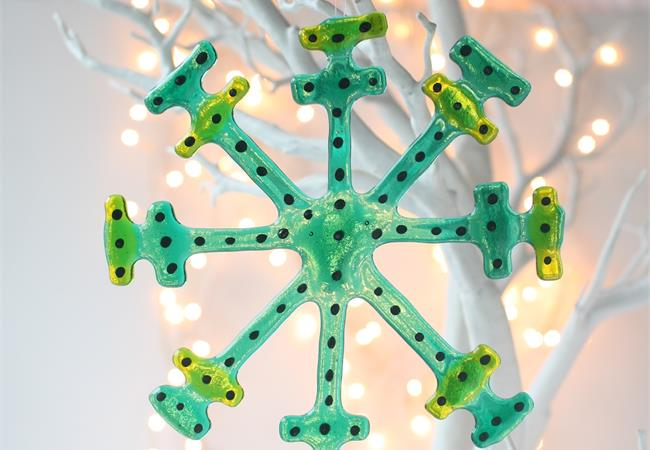 Emerald fused glass snow flake hanging decoration made by molten wonky