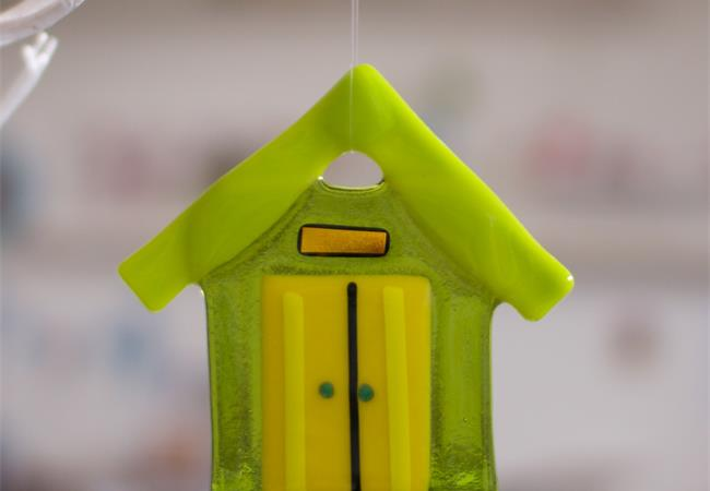 handmade colourful glass beach hut by molten wonky