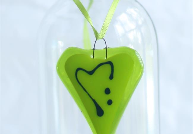 little green fused glass love heart hanging decoration made by molten wonky