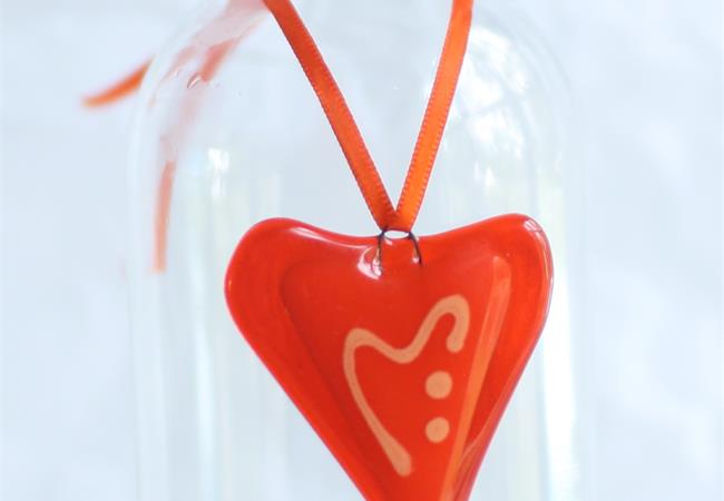 little orange fused glass love heart hanging decoration made by molten wonky