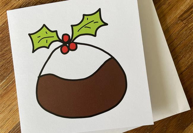Christmas card with seasonal pudding