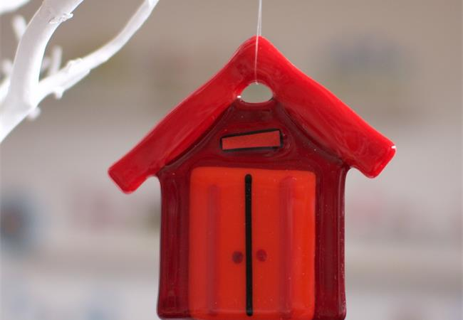 red fused glass beach hut