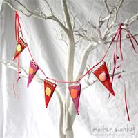 shimer dot red coloured fused glass bunting made by molten wonky